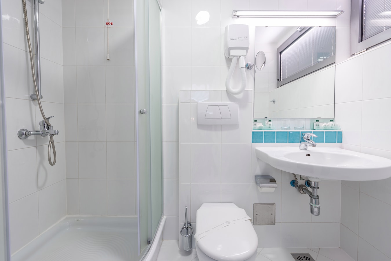 uvlala-hotel-room-bathroom-shower.jpg